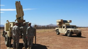 Soldiers inspect the Sentinel radar system that was recently deployed in Douglas, Arizona March 15, 2012. The Avenger Air Defense System is to their right. A highly specialized U.S. military task force is helping federal police hunt elusive drug traffickers slipping over the Mexico border in hard-to-detect utlralight aircraft, officials said on Thursday. REUTERS/Curt Prendergast