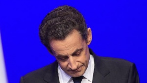 Nicolas Sarkozy, France's incumbent president, reacts after his defeat for re-election in the second round vote of the 2012 French presidential elections as he appears on stage before UMP party supporters at the Mutualite meeting hall in Paris May 6, 2012.  REUTERS/Yves Herman