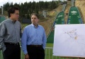 New International Olympic Commmittee President Dr. Jacques Rogge (R) and Salt Lake Olympic Committee President Mitt Romney (L) look over a map of the Utah Winter Sports Park, August 7, 2001 in Park City, Utah. REUTERS/Files