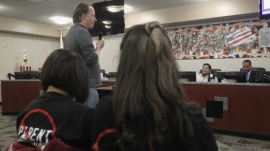 Patrick DeTemple, director of NGO Parent Revolution (2nd L), speaks during a Adelanto School District board meeting regarding the parent trigger law in Adelanto, California, March 6, 2012. REUTERS/Alex Gallardo