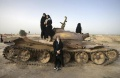 Women pose with an abandoned Iraqi tank for a photograph during their visit to a war memorial site southwest of Tehran. REUTERS/Morteza Nikoubaz