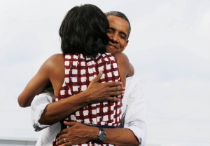 President Barack Obama hugs first lady, Michelle Obama, after she introduces him at a campaign event at the Village of East Davenport in Davenport, Iowa, August 15, 2012.   REUTERS/Larry Downing
