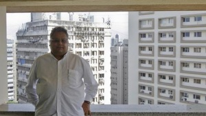 Investor Rakesh Jhunjhunwala poses for a picture at a balcony overlooking Mumbai's financial district June 8, 2012. REUTERS/Vivek Prakash/Files
