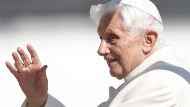 Pope Benedict XVI waves to the faithful as he arrives in St Peter's Square to hold his last general audience at the Vatican February 27, 2013. REUTERS/Alessandro Bianchi