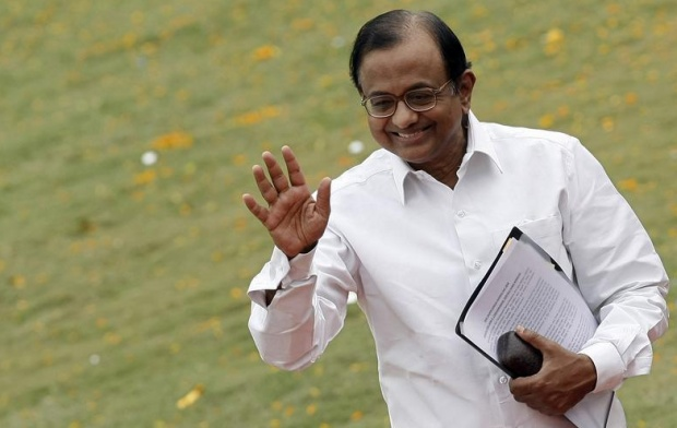 P. Chidambaram waves during a function to mark the 25th Raising Day of Indian National Security Guard (NSG) in Manesar, about 60 km south of New Delhi, October 16, 2009. REUTERS/Adnan Abidi/Files