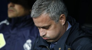 Real Madrid's coach Jose Mourinho concentrates before the start of their Spanish King's Cup final soccer match against Atletico Madrid at Santiago Bernabeu stadium in Madrid May 17, 2013.  REUTERS/Juan Medina