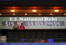 The U.S. national debt clock is displayed just after the opening session of the Republican National Convention in Tampa, Florida August 27, 2012.  REUTERS/Joe Skipper