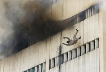 A man falls from a high floor of a burning building in central Lahore May 9, 2013. REUTERS/Damir Sagolj 