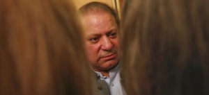 Nawaz Sharif (C), the leader of Pakistan Muslim League - Nawaz (PML-N), gestures as he speaks to foreign reporters at his residence in Lahore May 13, 2013.  REUTERS/Damir Sagolj