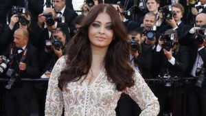 "Aishwarya Rai poses on the red carpet as she arrives for the screening of the film ""Blood Ties"" during the 66th Cannes Film Festival in Cannes May 20, 2013. REUTERS/Yves Herman"