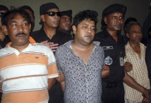 Members of the Rapid Action Battalion (RAB) present in Dhaka, Mohammed Sohel Rana (C) and an unidentified acquaintance (L) of Rana's, to the media after Rana's arrest in Jessore April 28, 2013.REUTERS/Stringer