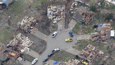 An aerial view of damage in a neighborhood in Moore, Oklahoma May 21, 2013, in the aftermath of a tornado which ravaged the suburb of Oklahoma City. Rescuers went building to building in search of victims and thousands of survivors were homeless on Tuesday, a day after a massive tornado tore through Moore, wiping out whole blocks of homes and killing at least 24 people. Seven children died at the school which took a direct hit in the deadliest tornado to hit the United States in two years.  REUTERS/Rick Wilking