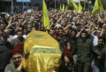 Supporters of Hezbollah and relatives of Hezbollah member Hussein Ahmad Abu Hasan carry his coffin during his funeral in Beirut's suburbs May 21, 2013. On a country road in Lebanon's northeast, traffic is heavy; ambulances screech by, sirens blaring, and cars packed with mourners follow coffins as Hezbollah brings wounded fighters home from Syria, and its dead. Having long denied its engagement in Syria behind President Bashar al-Assad, Hezbollah has committed itself this week to the fight for the strategic small town of Qusair, sending hundreds of men and losing dozens wounded and between 20 and 50 killed. Picture taken May 21, 2013. To match Analysis SYRIA-CRISIS/HEZBOLLAH