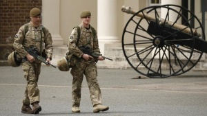 British troops patrol an army barracks near the scene of a killing in Woolwich, southeast London May 23, 2013. REUTERS/Luke MacGregor
