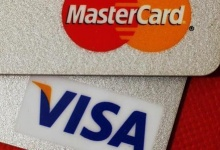 MasterCard and VISA credit cards are seen in this illustrative photograph taken in Hong Kong, December 8, 2010. REUTERS/Bobby Yip