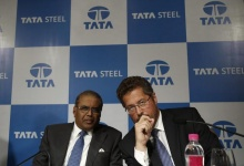 Tata Steel's Managing Director Hemant Nerurkar (L) and Tata Steel Europe's Managing Director Karl-Ulrich Koehler speak to each other before a news conference to announce their fourth quarter results in Mumbai May 23, 2013. REUTERS/Vivek Prakash