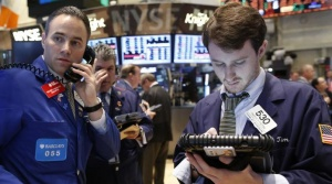 Specialist trader Jason Hardzewicz (L) talks on the phone on the floor at the New York Stock Exchange, May 22, 2013.  REUTERS/Brendan McDermid