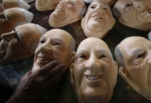 Masks bearing the likeness of Pope Francis are pictured on a factory assembly line in Sao Goncalo near Rio de Janeiro April 16, 2013. REUTERS/Sergio Moraes