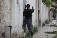 An Afghan policeman takes up a position after explosions in Kabul May 24, 2013. REUTERS/Omar Sobhani