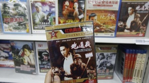 "Chinese film ""Tunnel Warfare"" featuring a small town defends itself from Japanese during the Second Sino-Japanese War, and other anti-Japan films are seen at a DVD shop during a photo opportunity in Beijing May 21, 2013.  REUTERS/Kim Kyung-Hoon"
