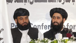 Muhammad Naeem (R), a spokesman for the Office of the Taliban of Afghanistan speaks during the opening of the Taliban Afghanistan Political Office in Doha June 18, 2013. REUTERS/Mohammed Dabbous