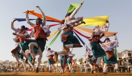 Supporters of Bharatiya Janata Party (BJP) perform folk dance at a rally to celebrate party's 33rd foundation day in Ahmedabad April 6, 2013. REUTERS/Amit Dave/Files
