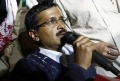 Arvind Kejriwal (C, holding microphone), leader of the newly formed Aam Aadmi (Common Man) Party, addresses the media after his election win against Delhi's chief minister Sheila Dikshit, at his party office in New Delhi December 8, 2013. REUTERS/Adnan Abidi
