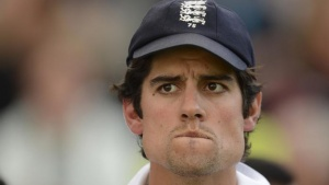 England's captain Alastair Cook waits for the presentations after England won the fourth Ashes cricket test match against Australia at the Riverside cricket ground in Chester-le-Street near Durham August 12, 2013. REUTERS/Philip Brown/Files
