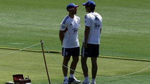England's cricket team captain Alastair Cook (R) talks with teammate Matt Prior next to the pitch during a training session at the Gabba cricket ground in Brisbane November 20, 2013. REUTERS/David Gray