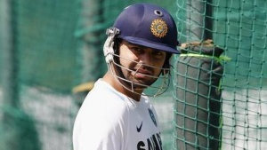 Virat Kohli prepares to bat in the nets during a practice session in Mohali October 19, 2011. REUTERS/Adnan Abidi/Files