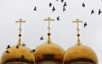 DONETSK: Birds fly over an Orthodox church in a monastery in the village of Nikolskoye, some 48 km (30 miles) from the eastern city of Donetsk, February 24, 2014. REUTERS/Vasily Fedosenko