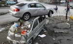 A car sits atop another in an area affected by an earthquake and tsunami in Miyako, Iwate prefecture March 14, 2011. REUTERS/Aly Song