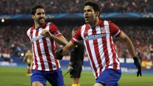 Atletico Madrid's Diego Costa (R) celebrates with teammate Raul Garcia after scoring a goal against AC Milan during their Champions League last 16 second leg soccer match at Vicente Calderon stadium in Madrid March 11, 2014. REUTERS/Sergio Perez