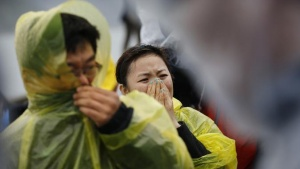 Family members of passengers missing on the overturned South Korean ferry Sewol, react at the port in Jindo April 17, 2014. REUTERS/Kim Kyung-Hoon