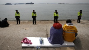 Family members of a missing passenger onboard the South Korean ferry Sewol which capsized on Wednesday, look at the sea as they wait for news from a rescue team, at a port in Jindo April 19, 2014. REUTERS/Kim Kyung-Hoon