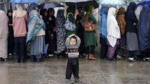 Afghan women stand in line as they wait to vote at a polling station in Kabul April 5, 2014. REUTERS/Mohammad Ismail