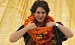 Priyanka Gandhi Vadra, daughter of Congress party chief Sonia Gandhi, adjusts her flower garlands as she campaigns for her mother during an election meeting at Rae Bareli in Uttar Pradesh April 22, 2014. REUTERS/Pawan Kumar