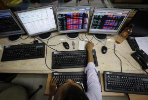 A broker monitors share prices while trading at a brokerage firm in Mumbai May 13, 2014. REUTERS/Danish Siddiqui/Files