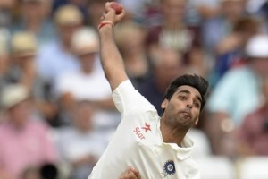 India's Bhuvneshwar Kumar bowls during the first cricket test match against England at Trent Bridge cricket ground in Nottingham, England July 11, 2014. REUTERS/Philip Brown