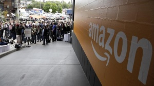 Media wait outside for the Amazon news conference where Amazon CEO Jeff Bezos introduced his company's new Fire smartphone in Seattle, Washington June 18, 2014. REUTERS/Jason Redmond/Files