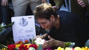 The mother of fallen reserve Israeli soldier Yair Ashkenazy mourns during his funeral in Rehovot near Tel Aviv July 25, 2014. REUTERS/Ronen Zvulun
