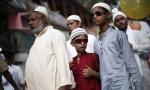 A Muslim family leaves after offering Eid al-Fitr prayers outside the Jama Masjid in the old quarters of Delhi July 29, 2014. REUTERS/Adnan Abidi