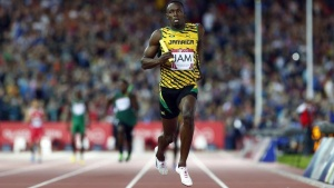 Usain Bolt croses the finish line as Jamaica wins their first heat in the men's 4x100m relay at the 2014 Commonwealth Games in Glasgow, Scotland, August 1, 2014. REUTERS/Andrew Winning
