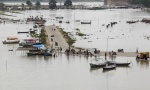 A view of a flooded road on the banks of river Ganga after heavy monsoon rains in Allahabad August 9, 2014. REUTERS/Jitendra Prakash