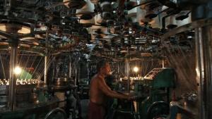 An employee works inside an undergarment factory in Kolkata March 10, 2014. REUTERS/Rupak De Chowdhuri/Files