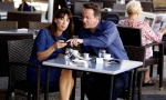 Britain's Prime Minister David Cameron and his wife Samantha sit at a cafe during a holiday in Majorca, Spain August 14, 2012. REUTERS/Peter Byrne/POOL/Files