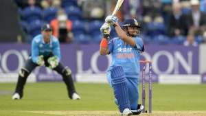 India's Suresh Raina hits out during the second one-day international cricket match against England at the SWALEC stadium in Cardiff August 27, 2014.  REUTERS/Philip Brown