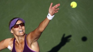 Mirjana Lucic-Baroni of Croatia serves to Simona Halep of Romania during their match at the 2014 U.S. Open tennis tournament in New York, August 29, 2014. REUTERS/Adam Hunger