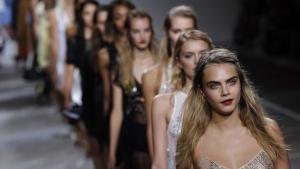 Cara Delevingne leads models in the finale of the Topshop Unique Spring/Summer 2015 collection presentation during London Fashion Week September 14, 2014. REUTERS/Suzanne Plunkett