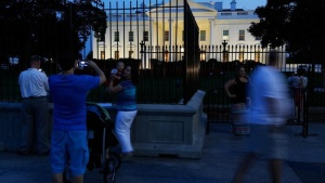 People take pictures outside the White House in Washington September 10, 2014. REUTERS/Jonathan Ernst